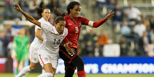 Photo: Trinidad and Tobago captain Maylee Attin-Johnson (right) battles with a US opponent during the 2014 CONCACAF Championship. (Courtesy CONCACAF)