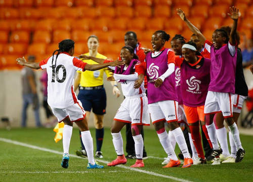 Photo: Trinidad and Tobago attacker Tasha St Louis (far left) celebrates with teammates after her stunning game winning goal against Guatemala in Houston, Texas. (Courtesy CONCACAF)