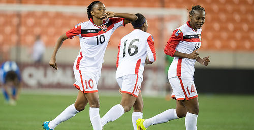Photo: Trinidad and Tobago goal scorer Tasha St Louis (left) and teammate Karyn Forbes (right) celebrate during their 2-1 Rio Olympic qualifying win over Guatemala last night in Houston. (Courtesy CONCACAF)