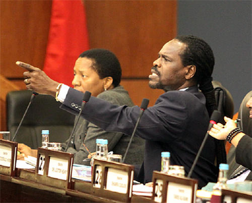 Photo: Minister of Public Utilities and ex-Works and Transport Minister Fitzgerald Hinds (right). (Copyright Power 102)
