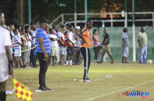 Photo: San Juan Jabloteh coach Keith Jeffrey (right) and Defence Force coach Marvin Gordon look on during Pro League action on 12 March 2016 at the Barataria Recreation Ground. (Courtesy Nicholas Bhajan/Wired868)