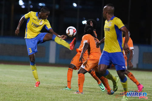 Photo: Defence Force central defender Jamali Garcia (left) in TT Pro League action against Club Sando on 22 January 2016. Garcia was one of seven debutantes for the Trinidad and Tobago National Senior Team against Grenada on March 19. (Courtesy: Chevaughn Christopher/Wired868)