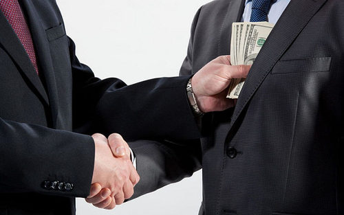 Photo: Bribery is one of the talking points at the Trinidad and Tobago Transparency Institute's anti-corruption conference. (Courtesy Telegraph UK)