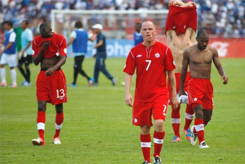 Photo: Canada players leave the field after their 8-1 World Cup qualifying loss to Honduras on 16 October 2012. (Copyright Vancouver Sun)