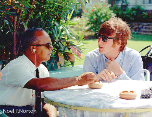 Photo: Trinidad and Tobago's first prime minister Dr Eric Williams (left) hosts late Beatles pop star John Lennon. (Copyright Noel P Norton)