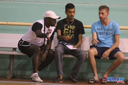 Photo: Trinidad and Tobago National Futsal Team coach Clayton Morris (left) gesticulates during an interview with Wired868 reporter Amiel Mohammed (centre) at the Maloney Indoor Sport Arena. (Courtesy Chevaughn Christopher/CA-images/Wired868)