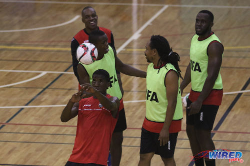 Photo: Trinidad and Tobago National Futsal Team player Jameel Neptune (left) heads the ball during training at the Maloney Indoor Complex. (Courtesy: Chevaughn Christopher/CA-images/Wired868)