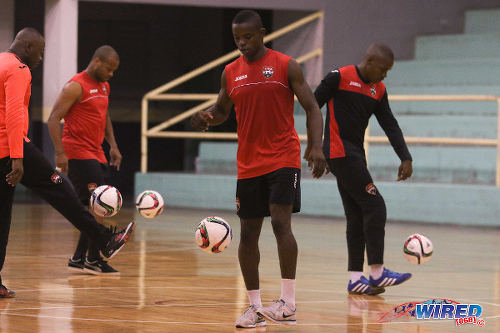 Photo: Kareem Perry (centre) and his teammates juggle the ball during Trinidad and Tobago National Futsal Team practice in March 2016. (Courtesy Chevaughn Christopher/CA-images/Wired868)