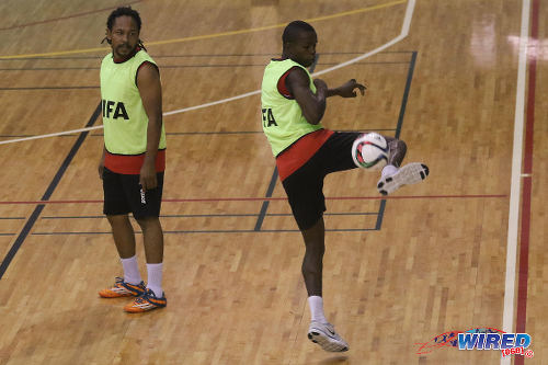 Photo: Trinidad and Tobago futsal player Kareem Perry (right) flicks the ball while teammate Ricardo Bennett watches on during a national practice session at the Maloney Indoor Complex. (Courtesy: Chevaughn Christopher/CA-images/Wired868)