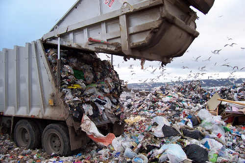 Photo: A garbage truck empties itself at a landfill. Killing us all softly with its crunch? (Courtesy St Louis County)