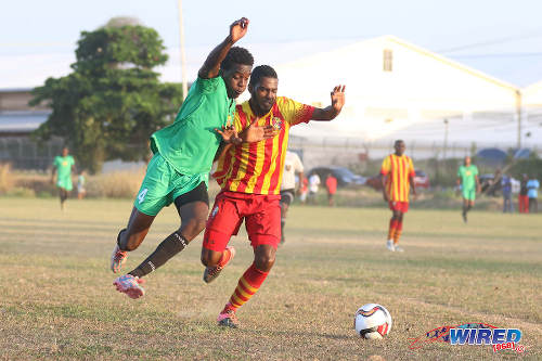 Photo: San Juan Jabloteh right back Garth Thomas (left) tries to get around Point Fortin Civic left back Shaquille Stewart during TT Pro League action at the Barataria Recreation Ground, Barataria on 5 March 2016. (Courtesy Chevaughn Christopher/Wired868)