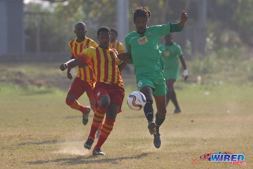 Photo: San Juan Jabloteh midfielder Marvin Oliver (right) completes a pass under pressure from a Point Fortin Civic opponent during TT Pro League action at the Barataria Recreation Ground, Barataria on 5 March 2016. (Courtesy Chevaughn Christopher/Wired868)