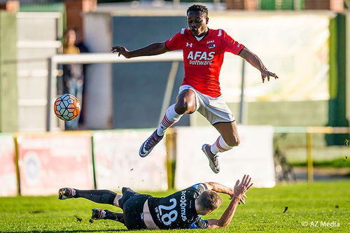 Photo: AZ Alkmaar winger Levi Garcia (top) hurdles an opponent during Eredivisie action in the 2015/16 season. (Copyright AZ Media)