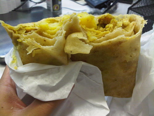 Photo: A roti meal. (Courtesy Caribbean Pot)