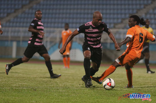 "Photo: North East Stars midfielder Ryan ""Fry"" Stewart (left) dribbles Club Sando left back Kemuel Rivers during their TT Pro League clash at the Ato Boldon Stadium on 1 March 2016. (Courtesy Chevaughn Christopher/Wired868)"