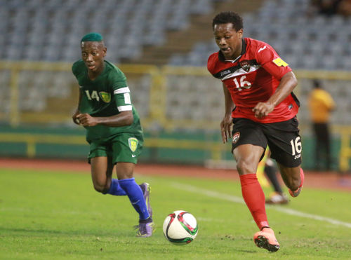 Photo: Trinidad and Tobago winger Levi Garcia (right) leaves St Vincent and the Grenadines right back Akeem Williams in his wake during Russia 2018 World Cup qualifying action at the Hasely Crawford Stadium, Port of Spain on 29 March 2016. Trinidad and Tobago won 6-0. (Courtesy: Nicholas Bhajan/Wired868)
