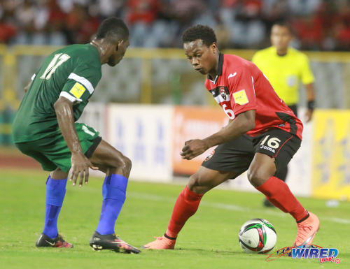 Photo: Trinidad and Tobago winger Levi Garcia (right) tricks his way past St Vincent and the Grenadines player Emerald George during Russia 2018 World Cup qualifying action at the Hasely Crawford Stadium, Port of Spain on 29 March 2016. Trinidad and Tobago won 6-0. (Courtesy: Nicholas Bhajan/Wired868)