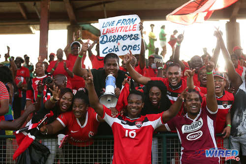 "Photo: Eighteen year old Trinidad and Tobago winger Levi Garcia (right) celebrates with ""Soca Warriors"" fans after his double set up a 3-2 World Cup qualifying win over St Vincent and the Grenadines at Arnos Vale on 25 March 2016. (Courtesy Allan V Crane/CA-images/Wired868)"