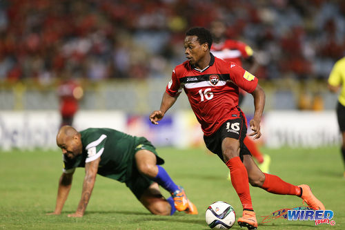 Photo: Trinidad and Tobago winger Levi Garcia (right) leaves St Vincent and the Grenadines defender Shawn Benjamin for dead during Russia 2018 World Cup qualifying action at the Hasely Crawford Stadium, Port of Spain on 29 March 2016. Trinidad and Tobago won 6-0. Garcia has declared his interest to represent the National Under-20 Team. (Courtesy Allan V Crane/CA Images/Wired868)