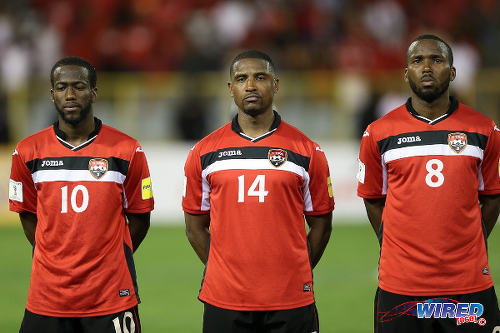 Photo: Trinidad and Tobago midfielders (from left) Kevin Molino, Andre Boucaud and Khaleem Hyland prepare for kick off against St Vincent and the Grenadines in Russia 2018 World Cup qualifying action at the Hasely Crawford Stadium, Port of Spain on 29 March 2016. Trinidad and Tobago won 6-0. (Courtesy: Allan V Crane/CA-images/Wired868)