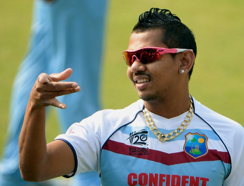 Photo: West Indies cricketer Sunil Narine trains at The Sher-e-Bangla National Cricket Stadium in Dhaka on April 2, 2014 during the ICC World Twenty20 cricket tournament.  (Copyright AFP 2016/Punit Paranjpe)