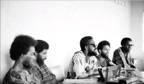 Photo: NJAC leader Makandal Daaga (centre) holds a press conference in 1970. (Courtesy Embau Moheni)