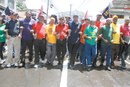 "Photo: Leaders of the All Trinidad General Trade Workers Union protest. ""We woh we money"" is their constant cry. (Courtesy ATGTWU)"