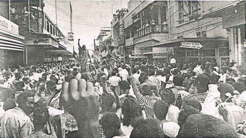 Photo: Mourners march down Frederick Street on 9 April 1970 for the funeral of the slain Basil Davis. (Courtesy Embau Moheni/NJAC)