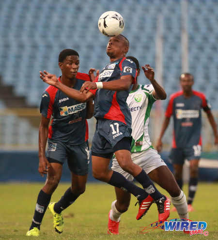 Photo: Morvant Caledonia United playmaker Akim Armstrong (centre) wins a header during the Lucozade Sport Goal Shield final against W Connection on 24 April 2016. Caledonia won 4-1 on kicks from the penalty mark. (Courtesy Nicholas Bhajan/Wired868)
