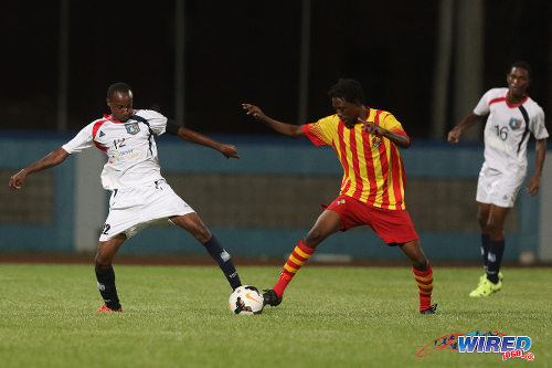 "Photo: Morvant Caledonia United captain Kareem ""Tiny"" Joseph (left) tries to reach the ball before a Point Fortin Civic opponent during Lucozade Sport Goal Shield qualifying action on 5 April 2016 at the Ato Boldon Stadium, Couva (Courtesy Chevaughn Christopher/CA-images/Wired868)"
