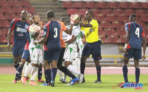 Photo: Morvant Caledonia United and Barbados international defender Ranaldo Bailey (number 3) and W Connection forward Shahdon Winchester (second from left) exchange pleasantries during the Lucozade Sport Goal Shield final on 21 April 2016. Caledonia won 4-1 on kicks from the penalty mark. (Courtesy Nicholas Bhajan/Wired868)