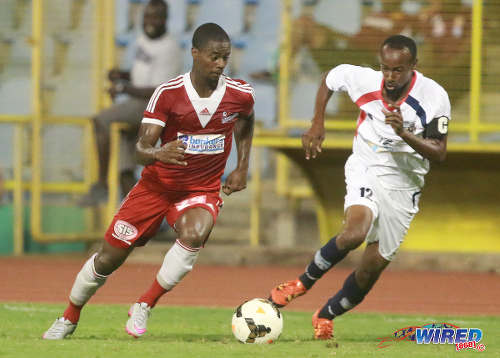Photo: Central FC defender Kevon Villaroel (left) takes on Morvant Caledonia United captain Kareem Joseph during Pro League on 19 April 2016 at the Hasely Crawford Stadium. Central won 3-0. (Courtesy Nicholas Bhajan/Wired868)