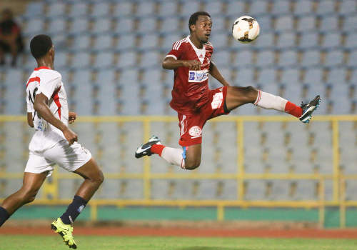 Photo: Central FC forward Marcus Joseph (right) goes airborne to control a pass while Morvant Caledonia United player Antonio Joseph looks on during Pro League on 19 April 2016 at the Hasely Crawford Stadium. Central won 3-0. (Courtesy Nicholas Bhajan/Wired868)