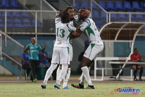 Photo: W Connection defender Alvin Jones (centre) is congratulated by teammates Daneil Cyrus (right) and captain Hughtun Hector after his goal against Central FC in the Lucozade Sport Goal Shield semifinal on 15 April 2016. Connection won 4-2. (Courtesy Chevaughn Christopher/Wired868)