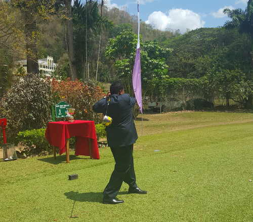 Photo: Sport Minister Darryl Smith tees off at the Open Golf competition. (Courtesy Ministry of Sport)