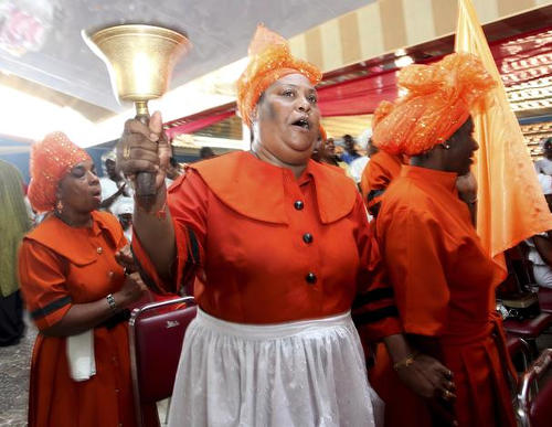 Photo: Spiritual Baptists ring the bell. (Copyright Washington Post)