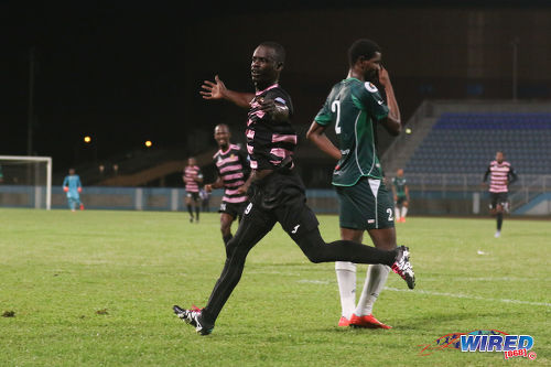 Photo: North East Stars forward Gorean Highley (left) celebrates his decisive strike while W Connection left back Kurt Frederick looks on during TT Pro League action on 2 April 2016. Police FC won 1-0. (Courtesy Chevaughn Christopher/CA-images/Wired868)