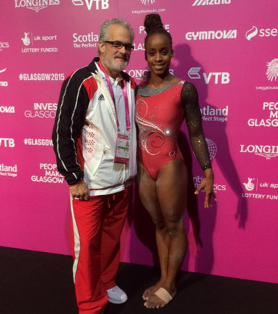 Photo: Trinidad and Tobago gymnast Thema Williams (right) and her coach John Geddert.