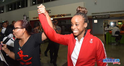 Photo: Trinidad and Tobago gymnast Thema Williams (right) is welcomed home from Rio by her godmother and entertainer Nikki Crosby at the Piarco International Airport on Wednesday 20 April 2016. (Courtesy Wired868)