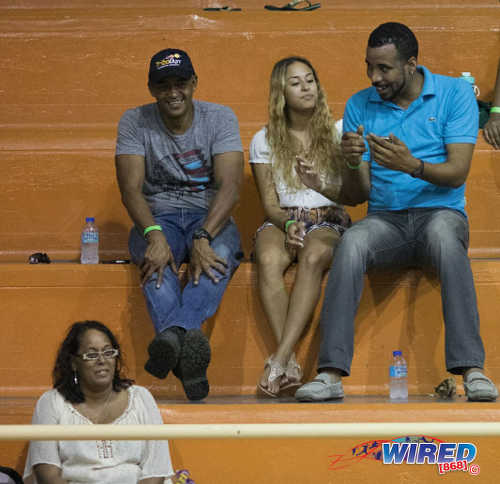 Photo: Trinidad and Tobago gymnast Marisa Dick (centre) talks to Trinidad and Tobago Gymnastics Federation (TTGF) first vice-president Akil Wattley (right) at a local gymnastics meet at the Tacarigua Indoor Sporting Facility on 23 April 2016. Looking on (bottom left) is Dick's mother, Hannifer Dick. (Courtesy Wired868)