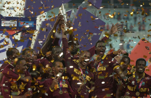 Photo: West Indies players celebrate after victory in the World T20 cricket final against England at The Eden Gardens Cricket Stadium in Kolkata on 3 April 2016. (Copyright AFP2016/Dibyangshu Sarkar)
