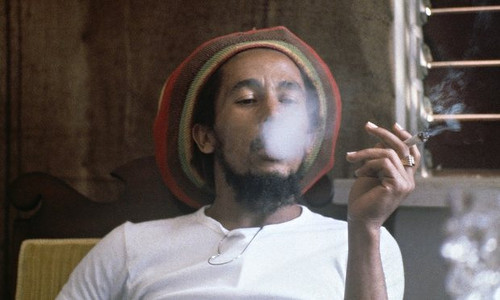 Photo: Late Reggae star Bob Marley takes a spliff. (Copyright UK Guardian)