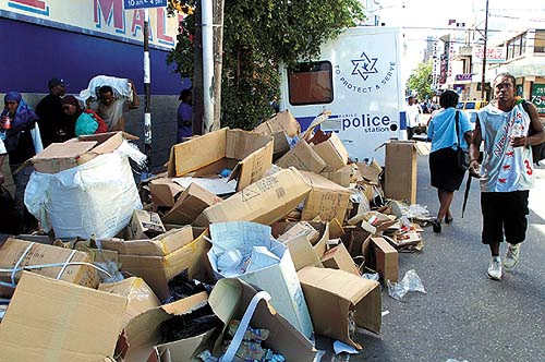 Photo: Garbage on Queen Street in Port of Spain. (Copyright Trinidad Guardian)