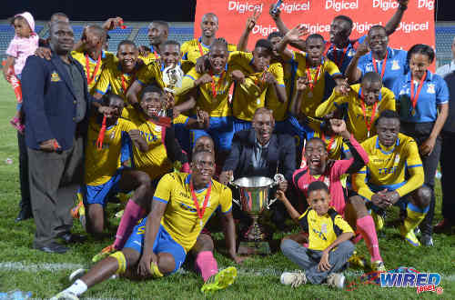 Photo: Cup that! Defence Force players celebrate after edging W Connection 2-1 in the Digicel Pro Bowl final on 27 May 2016 at the Ato Boldon Stadium in Couva. (Courtesy Chevaughn Christopher/Wired868)
