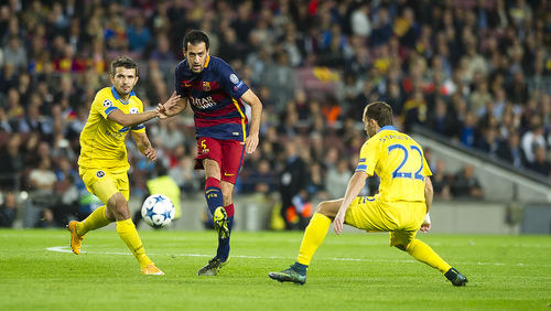 Photo: FC Barcelona midfielder Sergio Busquets (centre) in UEFA Champions League action against Bate Borisov on 4 November 2015. (Copyright FC Barcelona)