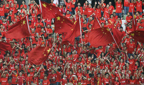 Photo: China football fans get behind their national team. (Copyright SCMP.com)