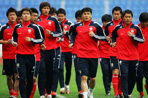 Photo: The China National Senior Team gets warmed up at a training session. (Copyright Al Azeera)