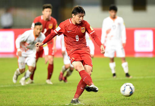 Photo: China attacker Yang Xu converts a penalty during international action. (Copyright China Daily)
