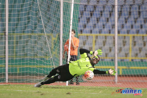 Photo: W Connection goalkeeper Julani Archibald dives to his left to keep out a penalty from North East Stars midfielder Kerry Daniel during the 2016 Pro Bowl semifinal on May 13 at the Hasely Crawford Stadium in Port of Spain. Connection won 4-2 on kicks from the penalty spot. (Courtesy Nicholas Bhajan/Wired868)