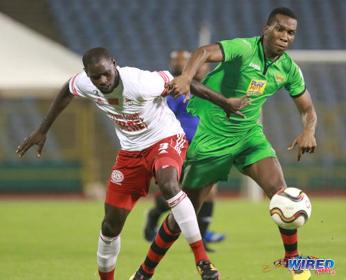 Photo: San Juan Jabloteh forward Jamal Gay (right) tries to force his way past Central FC defender Keion Goodridge during Pro League action on 17 May 2016 at the Hasely Crawford Stadium in Port of Spain. Gay scored twice as Jabloteh won 3-2. (Courtesy Nicholas Bhajan/Wired868)